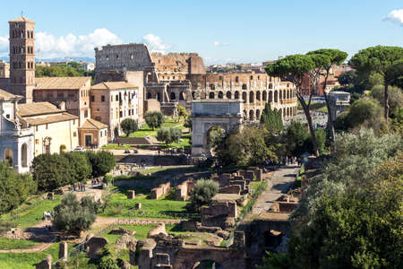 Ruins of the colosseum and arch of constantine in Rome, Italy Stock Photo