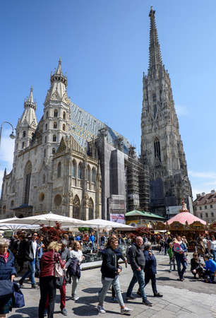 saint stephen cathedral: AUSTRIA, VIENNA - MAY 14, 2016: Photo of saint stephens cathedral and christmas market, is the mother church of the roman empire
