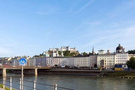 wolfgang: Salzburg skyline with festung hohensalzburg and river salzach salzburger land, bicycle sign, austria Stock Photo