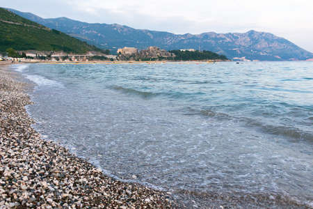 Budva the old town cloudy sky over clean sea at sunset, mountain island, montenegro, europe