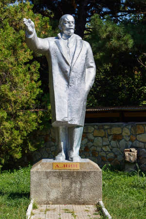 lenin: Vladimit Lenin statue with right hand in the air in Edinet park, north of republic of Moldova