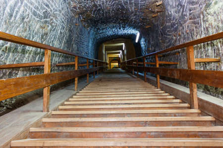 Sovata salt mine tunnel entrance with wooden stairs, romania