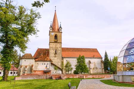 mid distance: Hungarian catholic church with garden, targu mures, romania