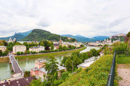 amadeus: Panoramic view over stadt salzburg with salzach river, rainy day, bridge and mountains, austria