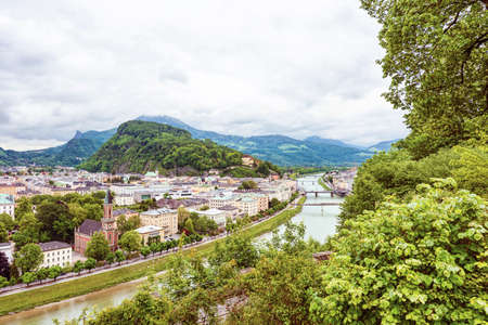 wolfgang: Panoramic view over stadt salzburg with salzach river, rainy day, bridge and mountains, austria