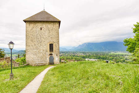 wolfgang: Panoramic view over stadt salzburg with ancient tower, rainy day and mountains, austria