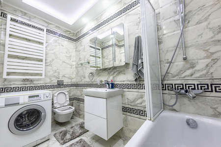 Stock Photo   Stock Photo White And Black Small Bathroom With Washing  Machine, Bathtub And Mirror, Chisinau, Moldova