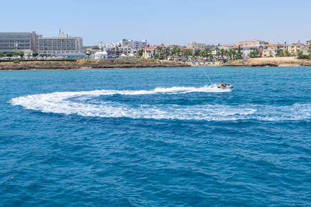 Sea view with people on water scooter, hotels and immaculate waters, protaras, cyprus island Stock Photo