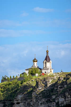Wonderful landscape with rocks and mountains at orheiul vechi monastery and memorial in moldova, near raut river, blue sky, sunny day, bell tower