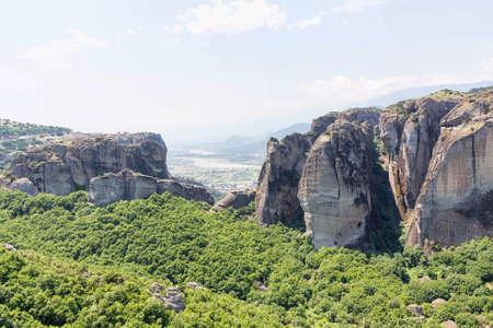 paleokastritsa: Green trees and rock mountains at sunset in Greece, Corfu