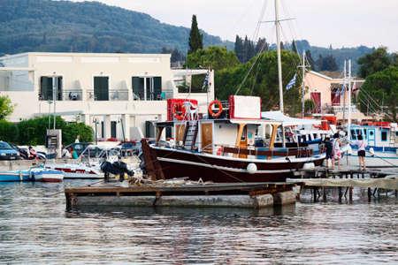 CORFU ISLAND, GREECE - JUNE 26, 2017: Pegasus Cruises company advertisement at coast of port in Greece, Corfu island