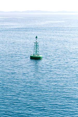 Green buoy floating in sea. Corfu island, Greece Stock Photo