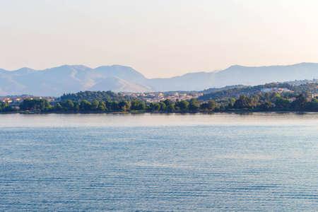 Sea view to city on Corfu island, Greece. Sunset