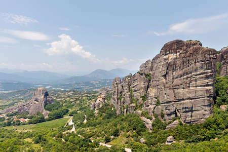 paleokastritsa: Green trees and rock mountains at daylight in Greece, Corfu Stock Photo