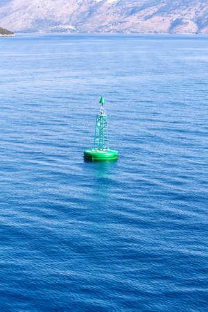 Green buoy floating in sea. Corfu island, Greece Imagens