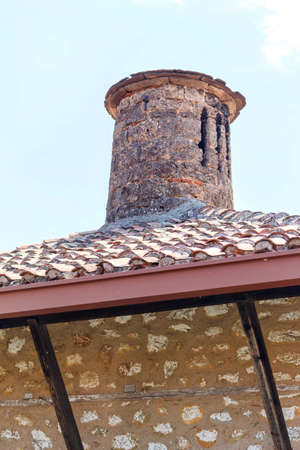 Old chimney on monastery building. Corfu island, Greece Stock Photo