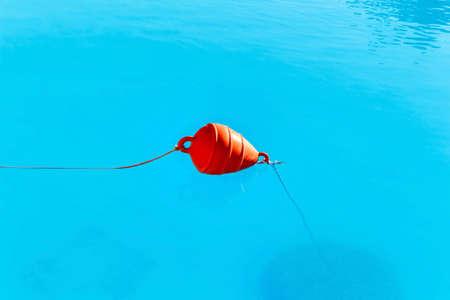 Beach marker buoys in sea. Greece, Corfu island, daylight view