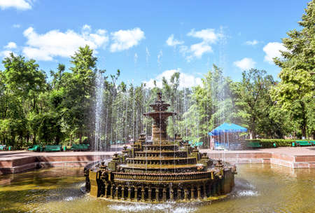 Central park with water fountain basin, Chisinau, Moldova, sunny day blue sky trees and flowers Stock Photo