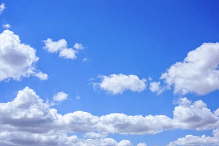 Beautiful big white clouds over blue sky, sunny summer day, close up