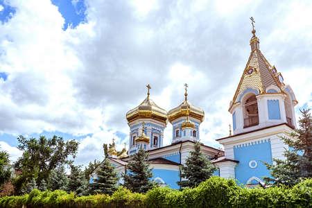 Ciuflea monastery sf teodor tiron, Chisinau, Moldova, sunny day blue sky trees and flowers Banco de Imagens
