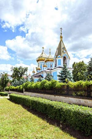 Ciuflea monastery sf teodor tiron, Chisinau, Moldova, sunny day blue sky trees and flowers Stock Photo