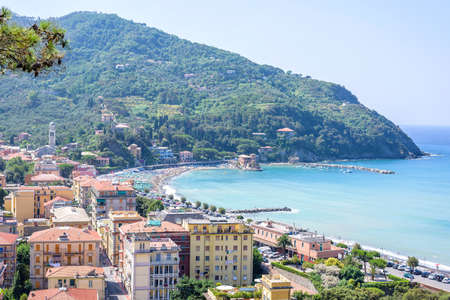 Beautiful daylight view to green mountains, blue sea and buildings of Levanto, Italy. Cinque Terre beauties Фото со стока