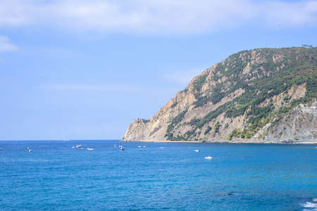 Beautiful daylight view to blue sea and green mountains. Monterosso al Mare, Italy. Cinque Terre Stock Photo