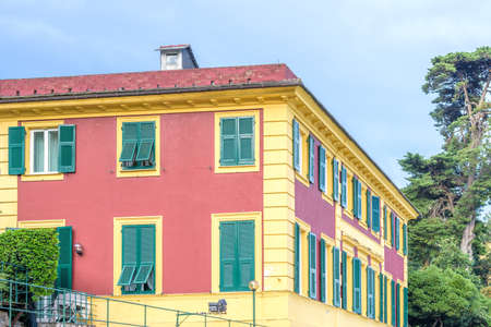 Daylight view on a red and yellow Hotel in Santa Margherita Ligure, Italy.
