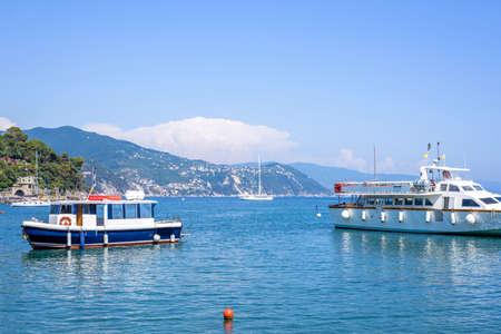 cruising: Beautiful view to city, beachline and ships cruising on water. Santa Margherita Ligure resort, Italy Stock Photo