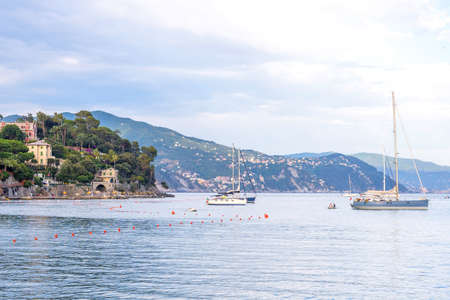 Daylight beautiful view to ships cruising on water and blue sky. Santa Margherita Ligure, Italy