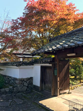 View from side to wooden entering gate in traditional japanese temple. Kyoto, Japan