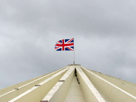 Flag of england floating on a building roof in southport, united kingdom