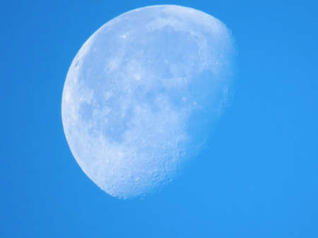 Big white moon close up over blue sky in the evening, southport, england, united kingdom                Stock Photo