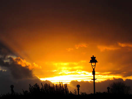 Yellow and golden hour sky at sunset in southport park, england, united kingdom Stock Photo