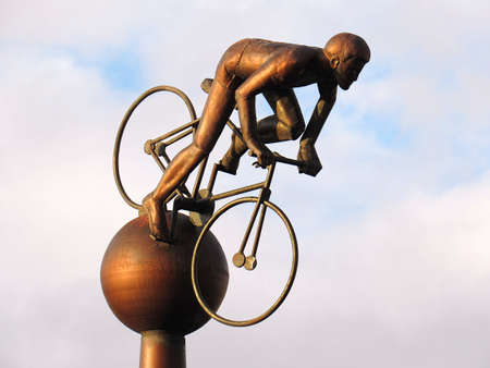 SOUTHPORT, UNITED KINGDOM - OCTOBER 23, 2017: Metalic statue of a sportmen riding a bike over blue sky Editöryel