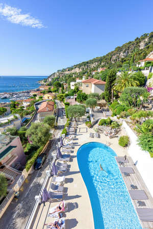 Hotel pool with people  NICE, FRANCE - JUNE 28, 2017: Daylight View To Hotel Pool With ...