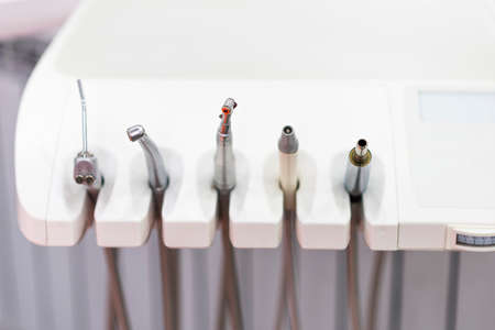 Close up shot to some dentistry tools. Modern looking medical equipment in the cabinet. Healthcare idea Stockfoto