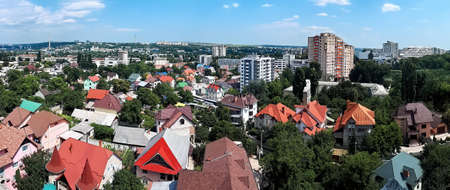 Panorama of Chisinau with lots of residential buildings and trees in Moldova Stock Photo