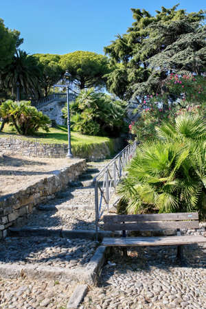 Stairs made of stone and lush greenery around in Sanremo, Italy