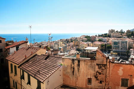 View of Sanremo with roofs of aged buildings on the foreground, Italy Stock Photo