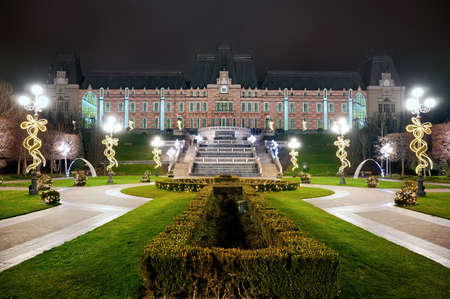 Palace of Culture at night with gardens on the foreground in Iasi, Romania