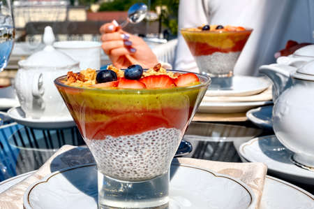 Chia pouding with fruits on a glass on a restaurant table