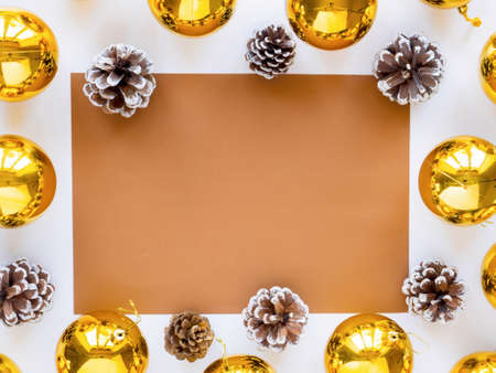Table with holiday attributes, decorations, and fir cones. White background. Holiday concept. Top view