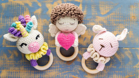 Three handmade knitted toys for kids. Top view Reklamní fotografie