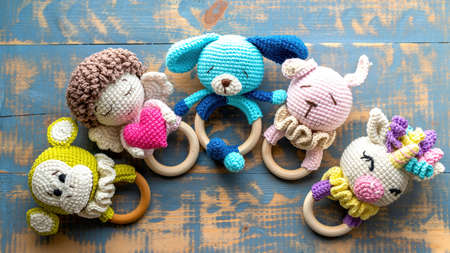 Five handmade knitted toys for kids. Top view Reklamní fotografie
