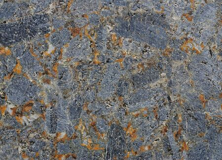 blotches: Texture of gray stone with rust-colored blotches