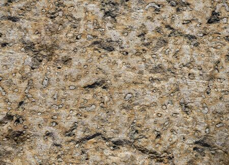 Texture of gray and rusty stone with round blotches