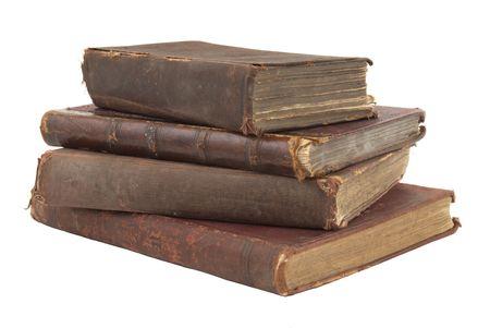 pile of books: Palo di vecchi libri isolati su sfondo bianco Archivio Fotografico