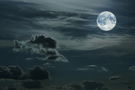 Sky with full moon, cumulus and cirrus clouds