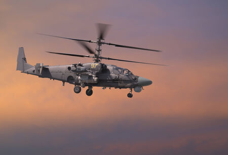 Attack helicopter i red sky